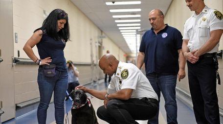 Suffolk Sheriff Errol Toulon Jr. greets Rocky on