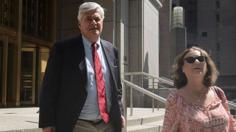 Dean Skelos, left, and his wife, Gail, leave