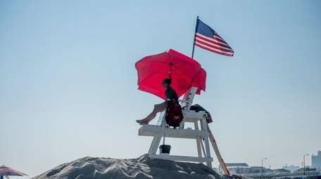 A lifeguard scans the water in Atlantic Beach