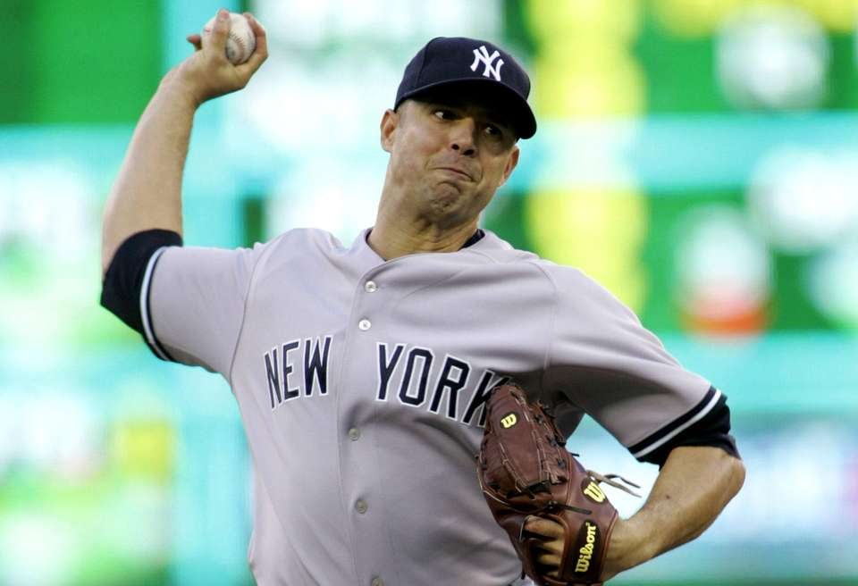 Yankees starting pitcher Javier Vazquez throws against the