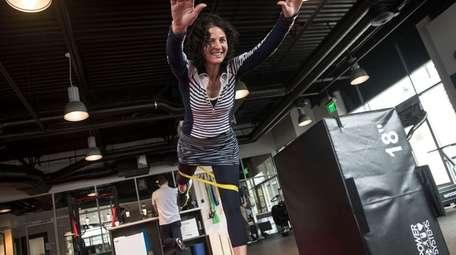 Joanna Cable, 52, does a strengthening exercise at