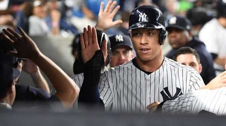 Yankees rightfielder Aaron Judge is greeted in the