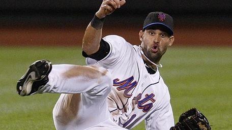 New York Mets center fielder Angel Pagan reacts