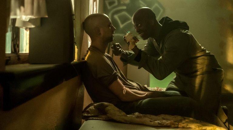 Actor Rotimi Paul as Skeletor kneels over an