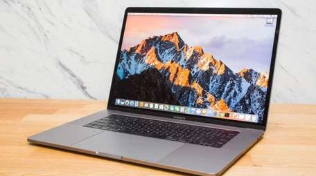 The Apple MacBook Pro with Touch Bar features