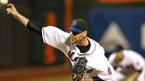 Mets starting pitcher Mike Pelfrey delivers in the