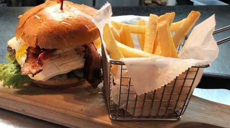 Bacon and egg burger with mozzarella cheese at