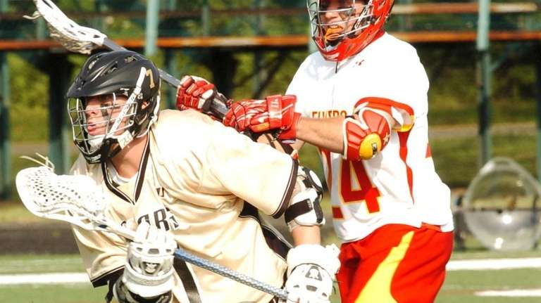 St. Anthony's Charlie Raffa, left, drives to the