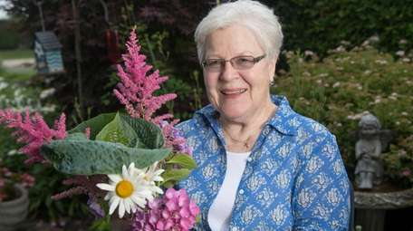 Helga K. Breen of Riverhead holds a bouquet