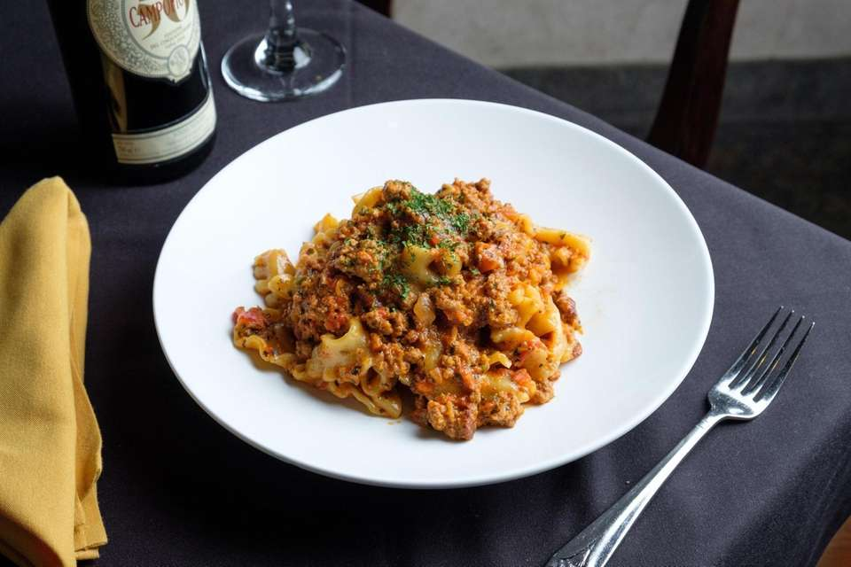 Pappardelle alla Bolognese arrives in a creamy, rich