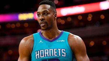 Hornets center Dwight Howard stands on the court