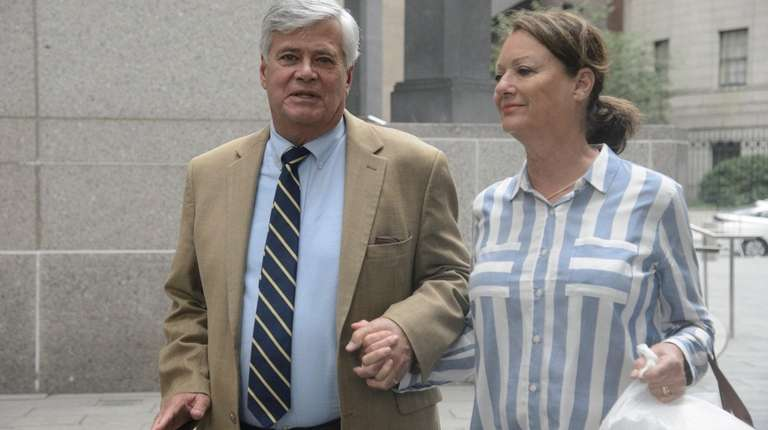 Dean Skelos and his wife, Gail, exit a