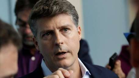 Yankees owner Hal Steinbrenner talks with reporters at