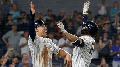 Yankees' Giancarlo Stanton celebrates his two-run home run