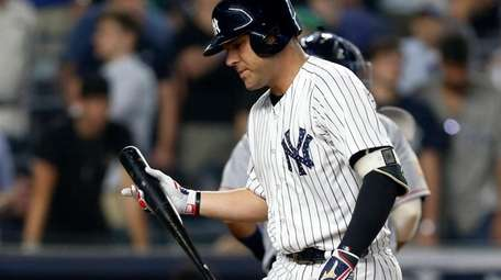 Austin Romine of the Yankees strikes out with