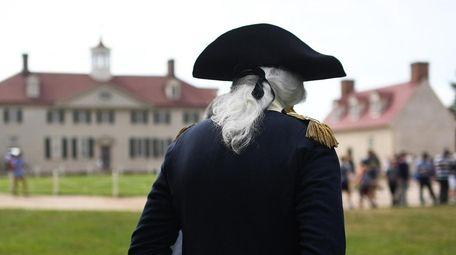 Dean Malissa portrays George Washington during a Fourth