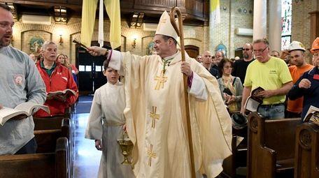 Bishop Robert Brennan, seen May 1 at St.