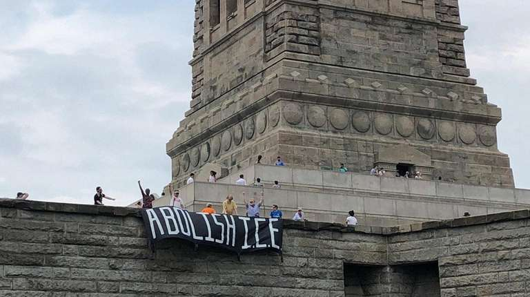 A protest at the Statue of Liberty was