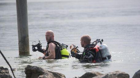 Mattituck Fire Department divers search the Mattituck Inlet