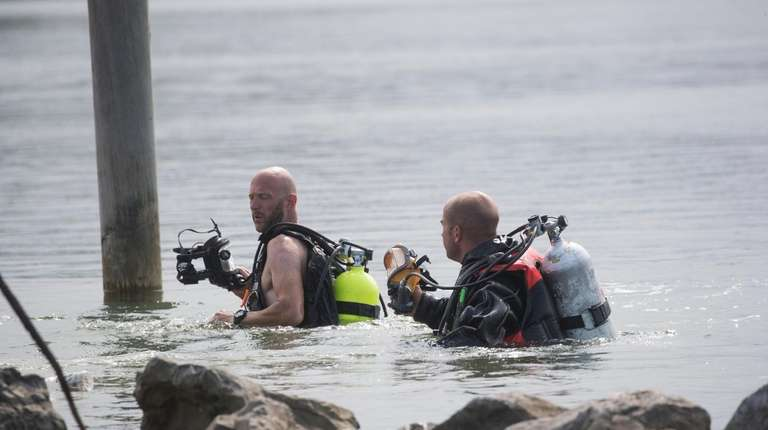 Mattituck Fire Department divers search the Mattituck Inlet