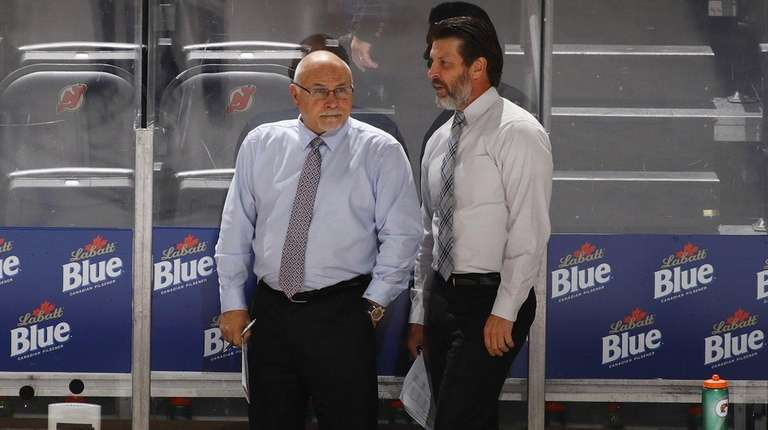 Head coach Barry Trotz (left) and assistant coach