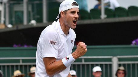 US player John Isner celebrates winning a point