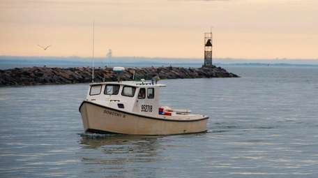 A commercial fishing vessel turns towards Gosman's Fish