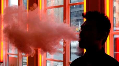 An e-cigarette smoker at a store in New