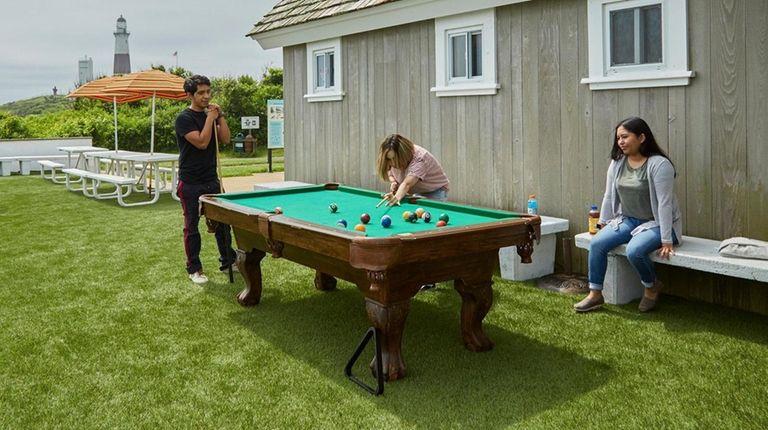 Visitors take advantage of a pool table outside