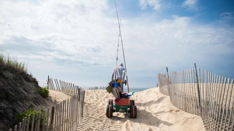 With a wagon full of fishing and beach