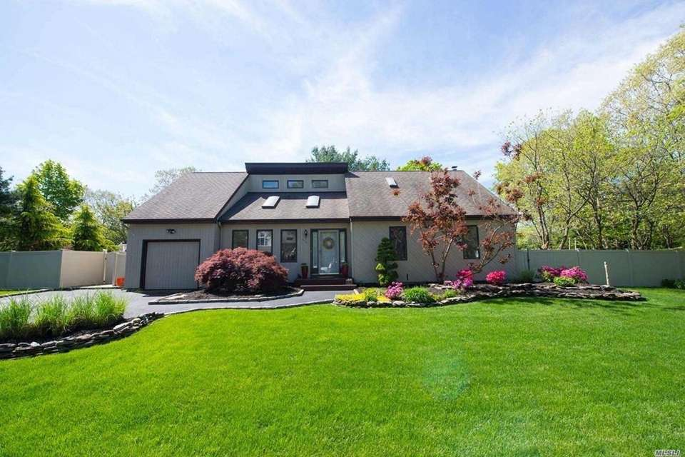 This Port Jefferson Station contemporary includes three bedrooms