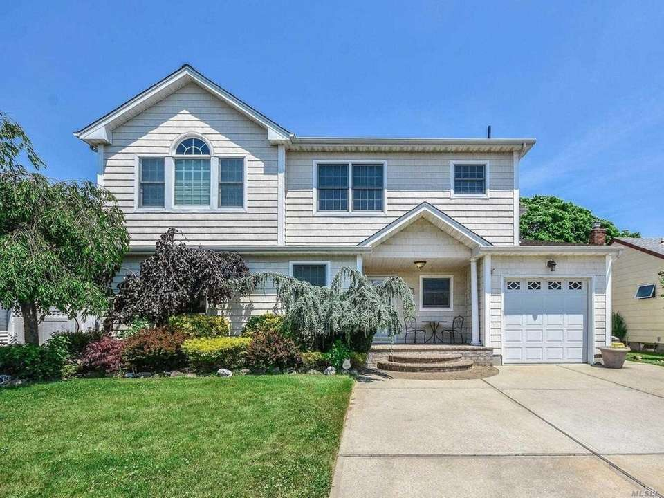 This North Massapequa Colonial includes five bedrooms and