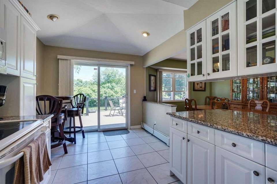 Sliding glass doors off the eat-in kitchen open