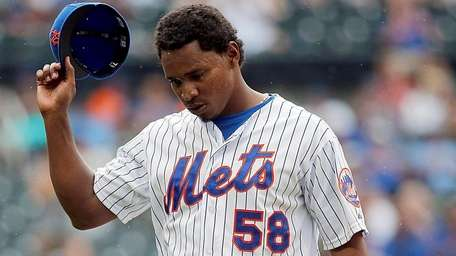 Mets relief pitcher Jenrry Mejia leaves the mound