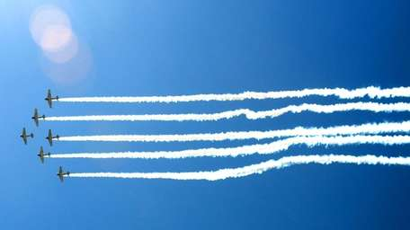 Planes perform tricks over Jones Beach during the