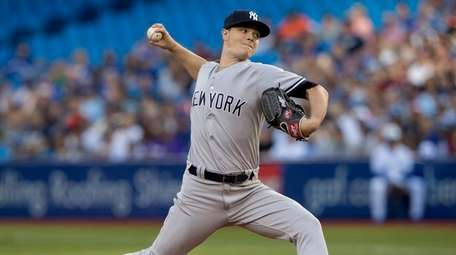 Yankees starting pitcher Sonny Gray throws to a