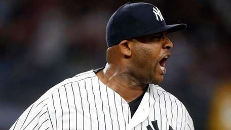 Yankees pitcher CC Sabathia reacts after getting the