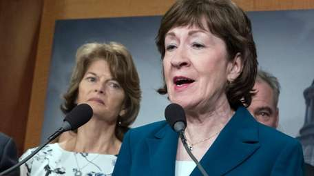 Sen. Susan Collins (R-Maine), right, and Sen. Lisa