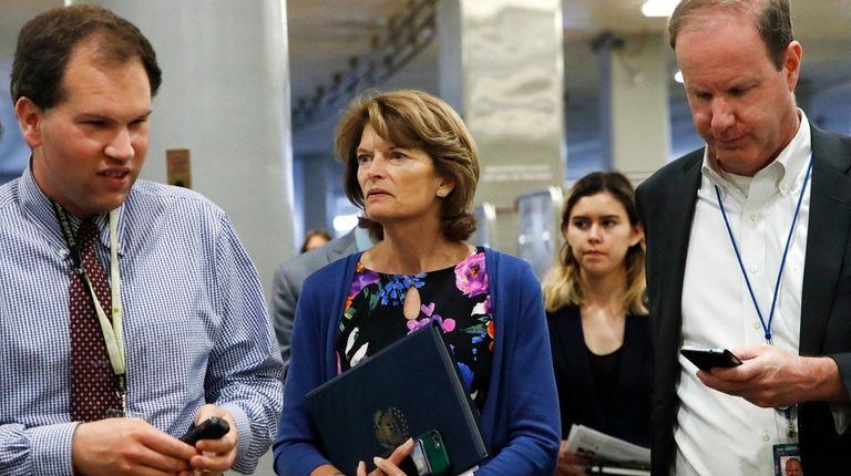 Sen. Lisa Murkowski(R-Alaska)is asked questions by reporters June