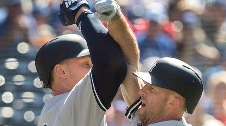 Yankees' Brett Gardner, is greeted by teammate Aaron
