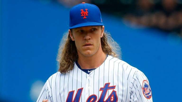 Noah Syndergaard of the Mets stands on the