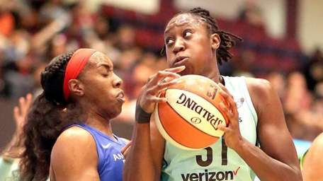 Liberty's Tina Charles crash inside against Wings Kayla
