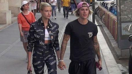 Hailey Baldwin and Justin Bieber walk down a