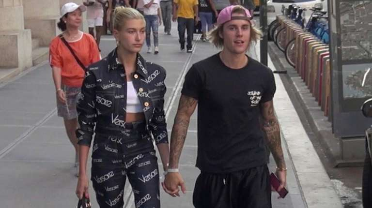 Hailey Baldwin and Justin Bieber walk down a