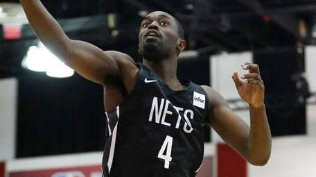 Nets' Theo Pinson grabs a rebound during the