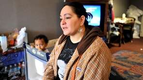 Rachel Perales with her 1-year-old son, Ishmael, talks