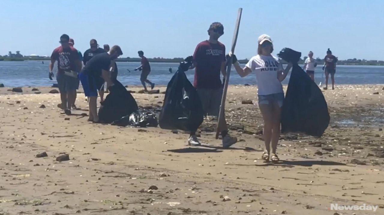 Volunteers help clean up the waters in Baldwin