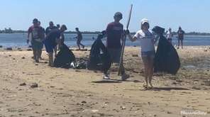 Volunteers help clean up the waters in Baldwin