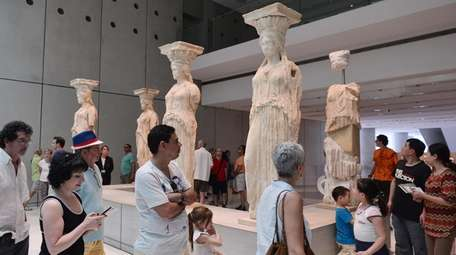 Tourists visit the Acropolis museum in Athens on