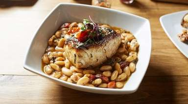 Local striped bass stop atop a white-bean ragout